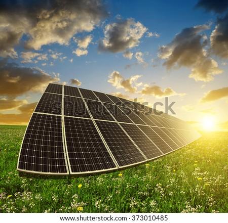Solar energy panels against sunset sky.Clean energy. - stock photo
