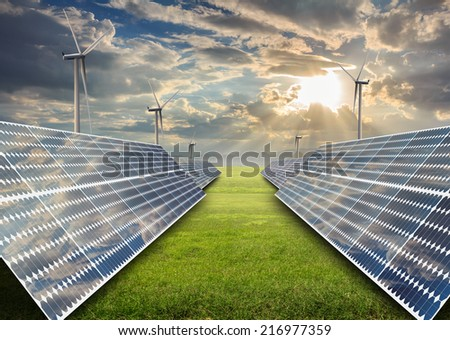 solar energy panels and wind turbine in sunset.
