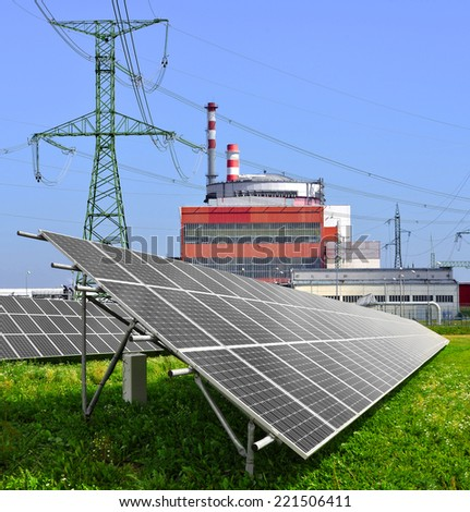 Solar energy panels before a reactor of nuclear power plant  - stock photo
