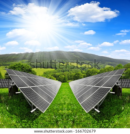 Solar energy panels in spring landscape  - stock photo