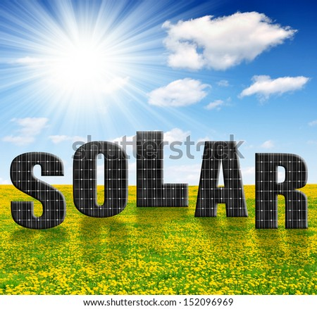 Solar energy panels on dandelion field  - stock photo