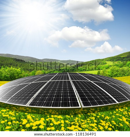 Solar energy panels on dandelion field against sunny sky - fisheye shot - stock photo