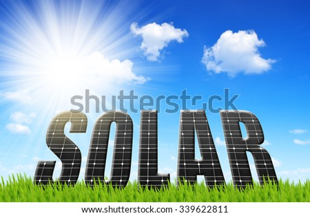 Solar energy panels on meadow. Concept of clean energy. - stock photo