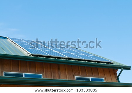 Solar Energy Panels on roof of building. Copy space. - stock photo