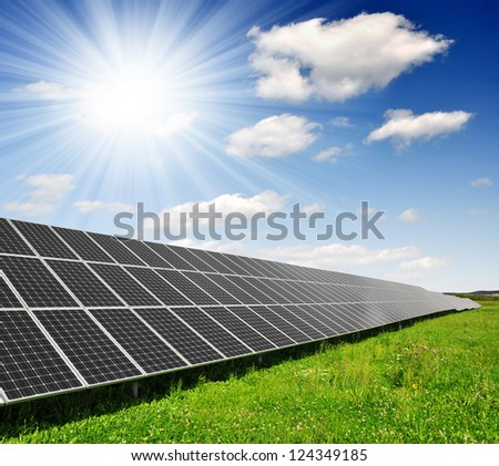 Solar energy  panels with blue sky - stock photo