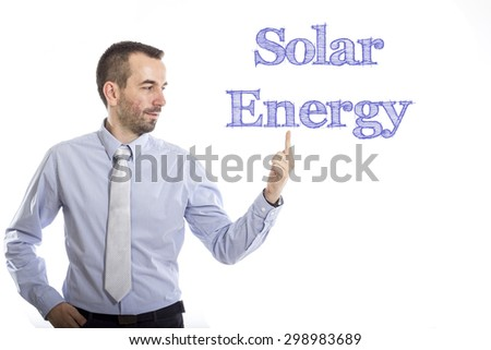 Solar Energy Young businessman with small beard touching text