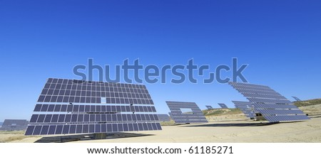 Solar field with blue and clear sky - stock photo