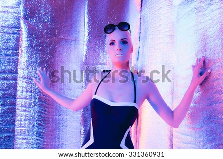 Solar futuristic blonde woman wearing swimsuit and sunglasses. Standing in reflective room.