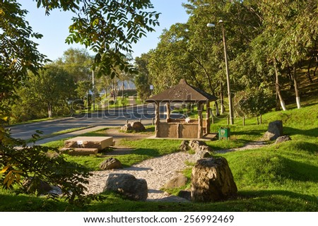 Solar gazebo on the edge of the forest. - stock photo