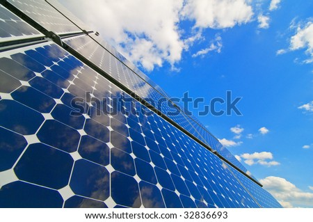 solar installation with sky - stock photo