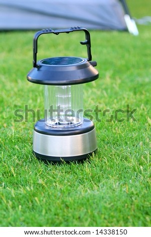 solar lantern on green grass