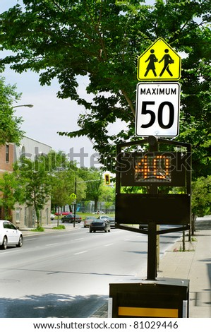 solar LED light community safety warning sign. driving speed danger  school children crossing control. - stock photo