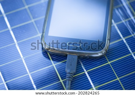 Solar Mobile Phone Chargers on grass in nature - stock photo