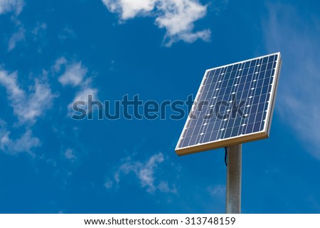Solar panel against a blue sky with light clouds - stock photo