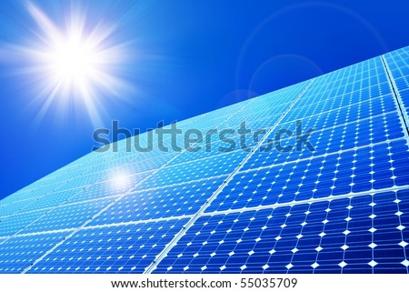 Solar panel against blue sky - stock photo