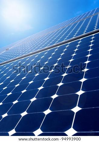 Solar panel against blue sky - stock photo