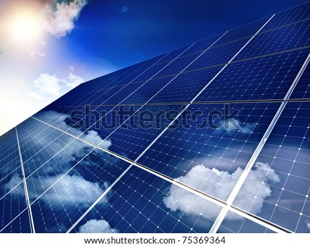 Solar panel against blue sky - free sun energy, - stock photo
