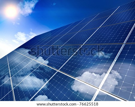 Solar panel against blue sky - free sun energy. - stock photo