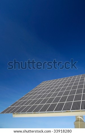Solar panel against blue sky. Good for issues such as renewable energies, air pollution, global warming. - stock photo