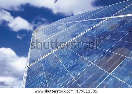Solar panel against cloudy sky