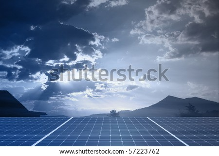 solar panel against sky with sun and sunbeams - stock photo