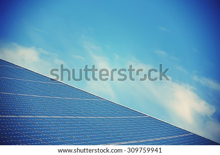 Solar panel against sunny blue sky  - stock photo