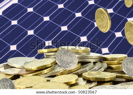 solar panel  and a heap of gold  coins - stock photo