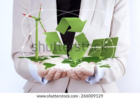 Solar Panel and Wind Turbine in women's hands - stock photo