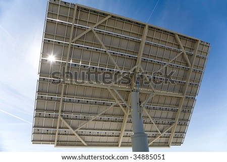 Solar panel back, against blue sky. Good for issues such as renewable energies, air pollution, global warming. - stock photo