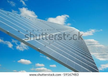Solar panel below blue sky - stock photo