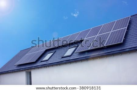 Solar Panel House. Renewable Energy, Blue Sky Bright Sun - stock photo