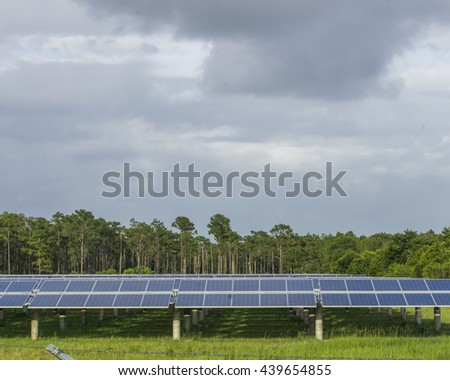 Solar Panel in an open field/Alternative energy/Power from light glistening in a grass field - stock photo