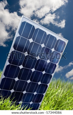 Solar panel in the fresh grass - stock photo