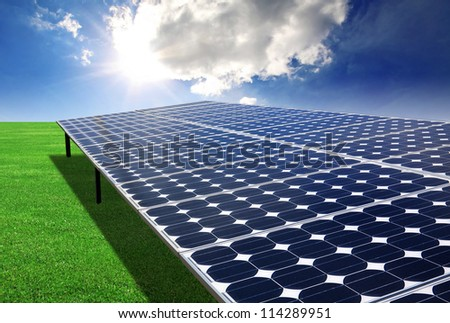Solar panel in the green field - stock photo