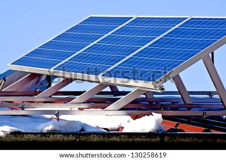 Solar panel in wintertime - stock photo