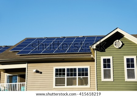 solar panel installed on the apartment roof - stock photo