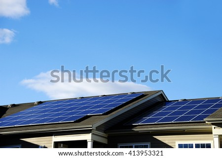 solar panel installed on the roof of apartment building - stock photo