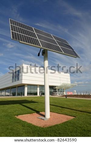 Solar panel near an office building - stock photo