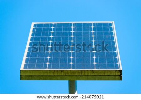 solar panel on a background of clear sky - stock photo