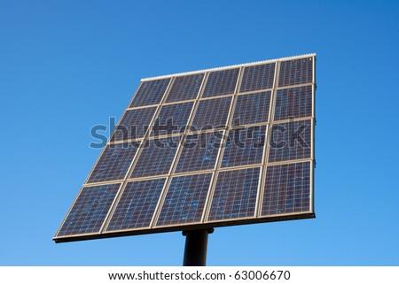 Solar panel on a blue sky - stock photo