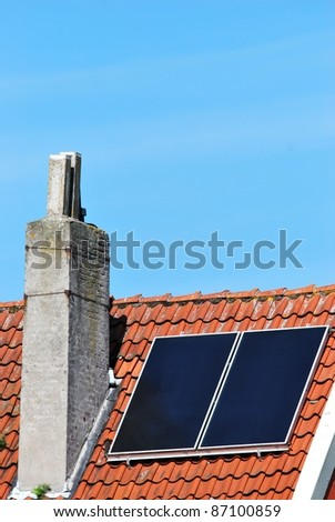 Solar panel on a old roof - stock photo