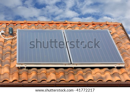 solar panel on a roof. hot water production - stock photo