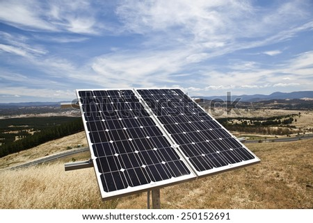 Solar panel on hill in front of stunning landscape in Australia - stock photo