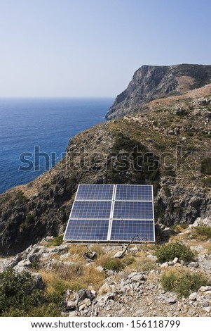 Solar panel on top of mountain with seascape