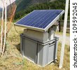 solar panel powered electric shepherd in the Swiss Alps - stock photo