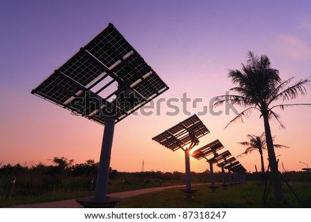 solar panel silhouette with beautiful sunset - stock photo
