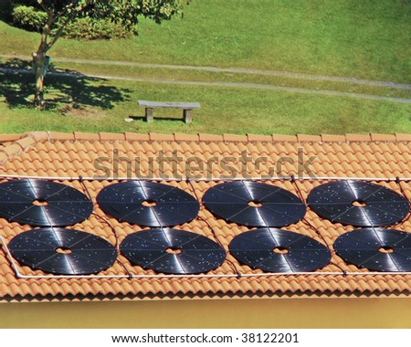 solar panel system  on the roof that is used for water heating - stock photo