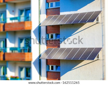 solar panel to produce clean green electricity at the wall of a residential house - stock photo