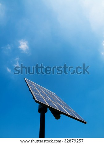Solar panel under blue sky with clouds - stock photo