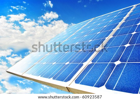 Solar Panel with background blue sky and white clouds - stock photo